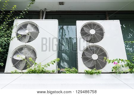 Duble twin fan ari compressor unit outside the office building.