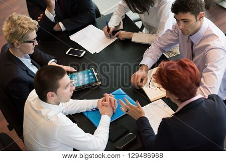 startup business people group have meeting in modern bright office interior, senior investors  and young software developers discuss about plans and projects