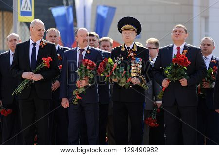 Orel Russia - May 9 2016: Celebration of 71th anniversary of the Victory Day (WWII). Vadim Potomsky Leonid Muzalevsky Nikolay Kovalev and other members of Orel Administration with flowers horizontal