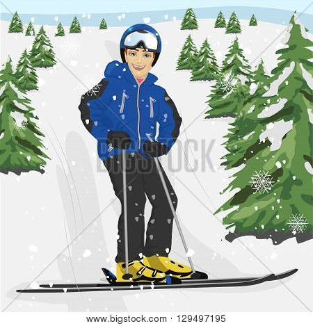 Young man skier standing on a snowy ski slope with trees