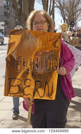 Asheville, North Carolina, USA - February 28, 2016: A crowd of enthusiastic Bernie Sanders supporters some in costume
