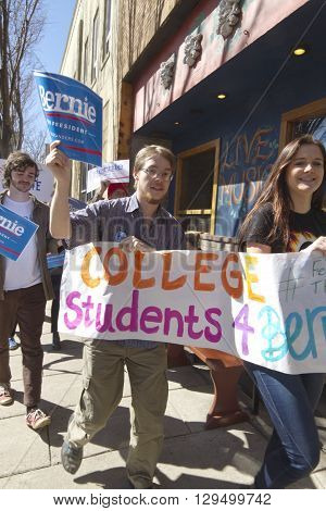 Asheville, North Carolina, USA - February 28, 2016: College students march through downtown Ashevillein support of Bernie Sanders during a political rally on February 28 2016 in Asheville, NC