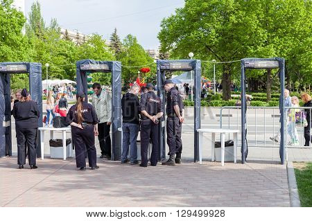 SAMARA RUSSIA - MAY 8 2016: Fence with police frames metal detectors at the central square in summer day