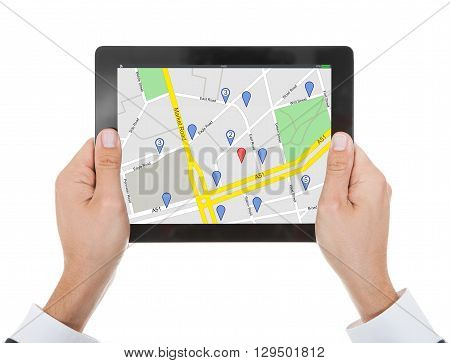 Close-up Of Person Holding Digital Tablet With Mark Location Icon Against White Background