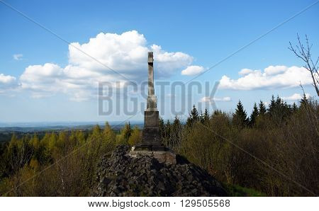 Crucifix on Spicak hill in Krusne hory mountains
