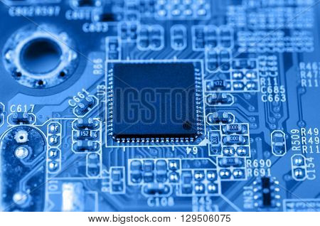 Closeup of electronic circuit board with chip. Macro with extremely shallow dof.