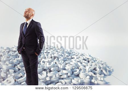 Businessman with a white question marks stack