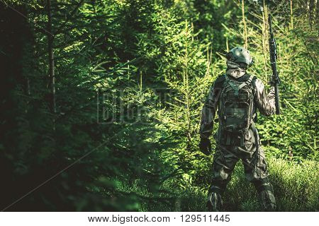 Soldier Mission in the Forest. Army Concept Photo.