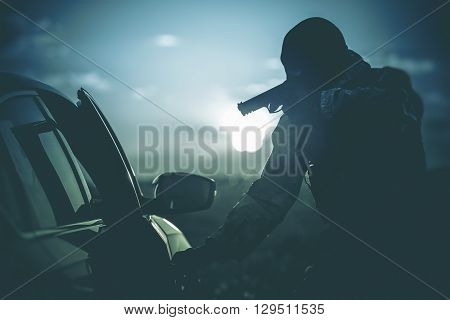 Vehicles Check Point Made by Police. Policeman in a Mask Points Gun at Suspicious Car Passenger. Anti Terrorism Check Point. Military Check Point.