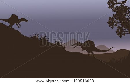 Silhouette of two spinosaurus in fields at the night
