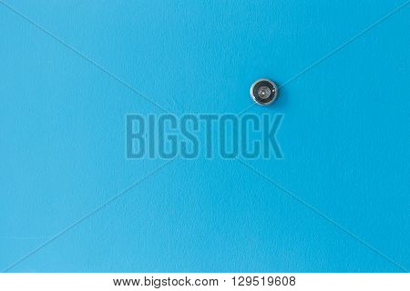 Door Lens Peephole On Blue Wooden Texture