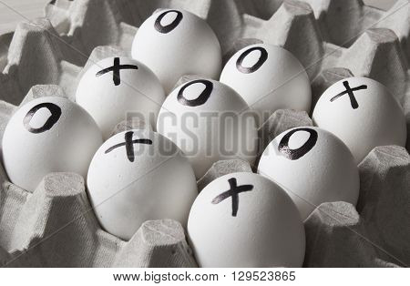 draw. Drawing on white eggs - tic-tac-toe game