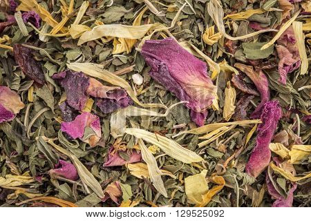 Macro of healthy stomach herbal tea -  a blend of  peppermint, spearmint, ginger, hibiscus, rosehip, red rose,, almond, and osmanthus.