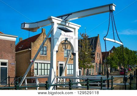 Monnickemdam Holland - July 24 2014: Waterland district a small drawbridge in the old town