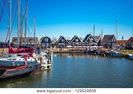 Marken Holland - July 24 2014: Waterland district people and boats in the little harbour