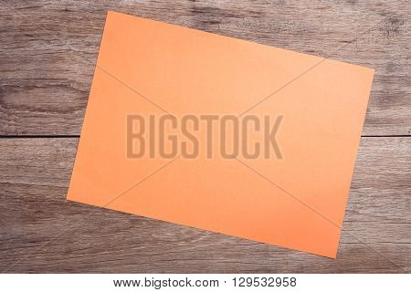Empty Orange Paper On Wooden Table Top View