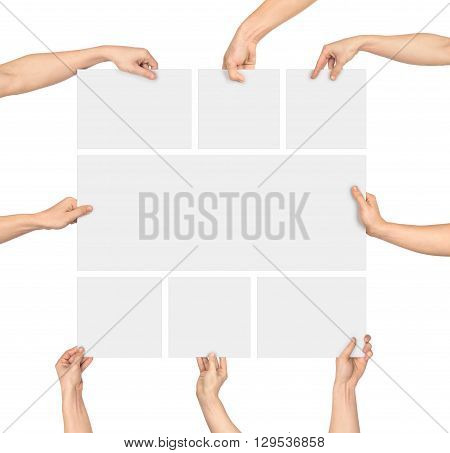 a hand holding a large blank sheet of paper isolated on white background