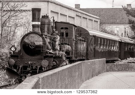 Veteran train in a curve in sepia colors poster