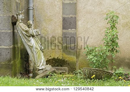 PONTGIBAUD FRANCE May 6 2016 : An old statue in Chateau-Dauphin medieval castle. The castle owes its name to the coat of arms of the Count of Auvergne who built it in the 12th century.