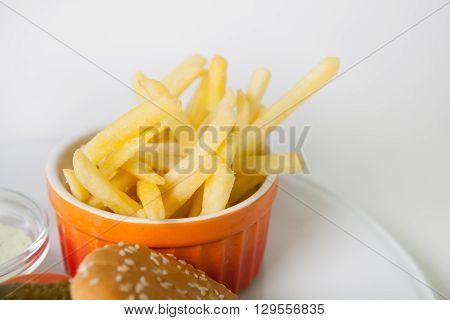 French fries potato as garnish on white plate