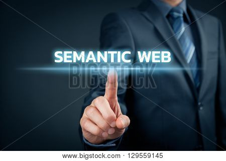 Businessman click on text semantic web (IT buzzword).