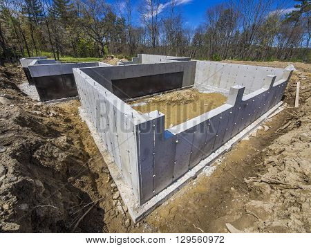Concrete foundation for a new house in the suburbs