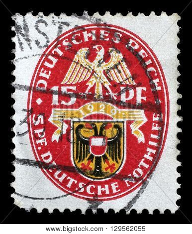 ZAGREB, CROATIA - JUNE 22: A stamp printed in the German Reich shows Coat of arms, Charity Stamps, circa 1928, on June 22, 2014, Zagreb, Croatia