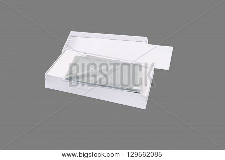 Tablet PC package. Isolated on a gray background.