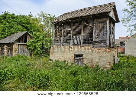 Rural old wooden warehouse for corn in the village.