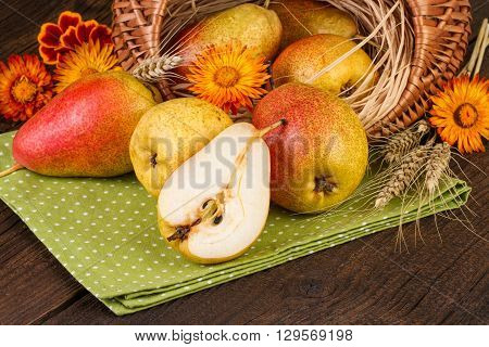 Basket of  pear fruits in retro style. Fall still life.