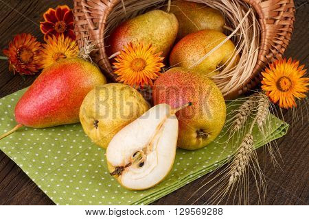 Thanksgiving Day decoration with ripe pears  decorated with flowers and wheat.