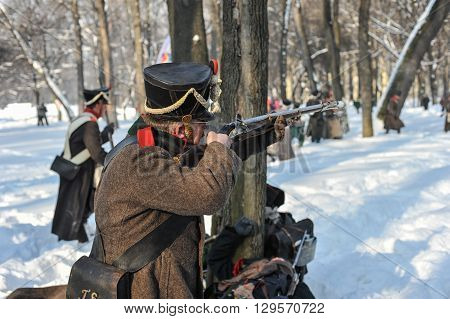 Saint-Petersburg Russia - February 23 2016: Reconstruction of the battle Russian grenadiers against the army of Napoleon . War of 1812. City park.