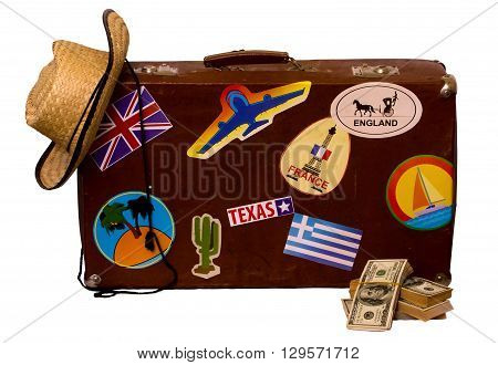 Vintage suitcase for travel with stickers of the countries visited straw hat and dollars