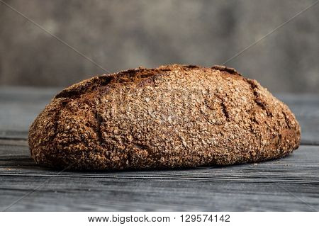 Bread on a dark wooden table with blurred background