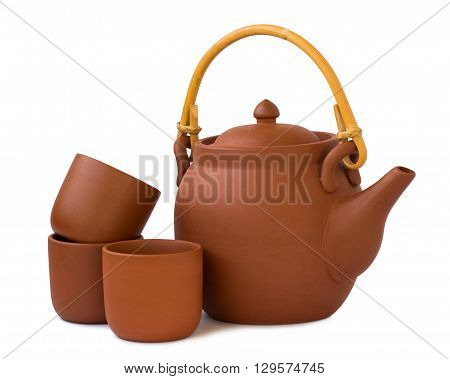 Clay teapot with cups isolated on white background