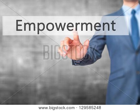 Empowerment - Businessman Hand Pressing Button On Touch Screen Interface.