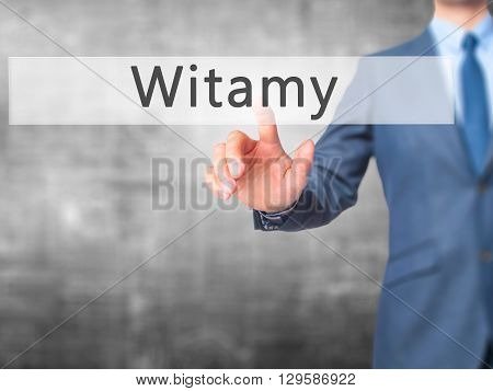 Witamy - Businessman Hand Pressing Button On Touch Screen Interface.