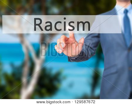 Racism - Businessman Hand Pressing Button On Touch Screen Interface.