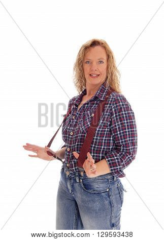 A meddle age woman in checkered shirt and jeans and red suspenders standing waist up isolated for white background.
