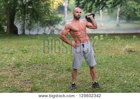 Fitness Kettlebell Swing Exercise Man Workout Outdoors