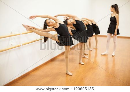 Girls Stretching During A Real Ballet Class