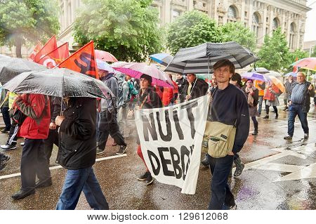 STRASBOURG FRANCE - MAY 12 2016: Nuit debout placard as thousand of people demonstrate as part of nationwide day of protest against labor reforms by France Government