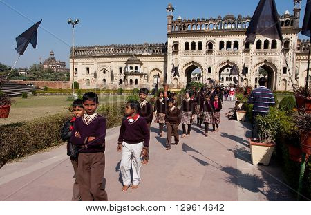 LUCKNOW, INDIA - DEC 19, 2012: Unidentified schoolchildren walking from the Gateway of Bara Imambara complex on December 19, 2012 in Lucknow India. Bara Imambara was built by Nawab of Lucknow in 1784.