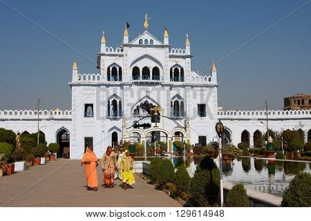 LUCKNOW, INDIA - DEC 19, 2013: Asian women walking around Hussainabad Imambara complex on December 19, 2012 in Lucknow India. Hussainabad or Chhota Imambara was built by the third Nawab of Awadh in 1838.