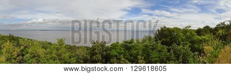 Forest river sky and white clouds in Ukraine