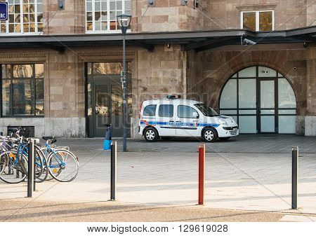 MULHOUSE FRANCE - DEC 19 2016: Police van Police Municipale parked outside Mulhouse Train Station parking area while soliders search for possible terrorists and for the security of the passengers