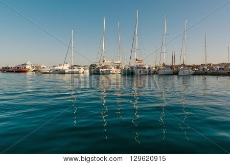 Sea bay with yachts at sunset in Egypt