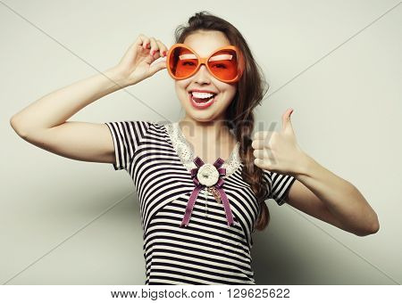 young woman with big party glasses