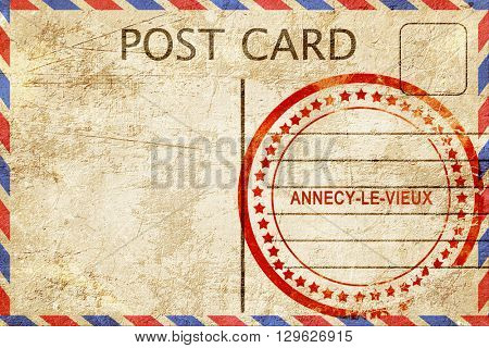 annecy-le-vieux, vintage postcard with a rough rubber stamp
