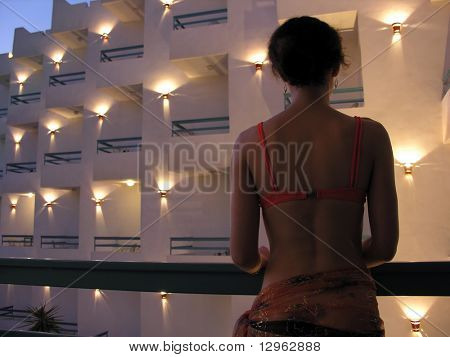 behind girl in hotel poster